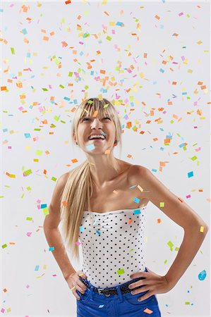 young woman with confetti flying Stock Photo - Premium Royalty-Free, Code: 6106-07070200