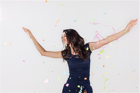 young woman with confetti flying Stock Photo - Premium Royalty-Free, Code: 6106-07070232