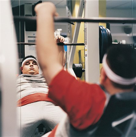 fat man exercising - Man Weight Training in a Gym Stock Photo - Premium Royalty-Free, Code: 6106-07002440