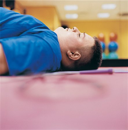 fat man exercising - Obese man Lying on the Floor of a Gym With his Eyes Closed Stock Photo - Premium Royalty-Free, Code: 6106-07002448
