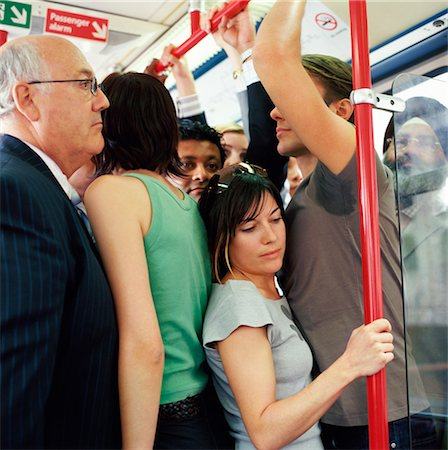 sweaty businessman - Group of Adults Stands Uncomfortably Crowded Onto a Passenger Train Stock Photo - Premium Royalty-Free, Code: 6106-07003189