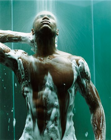 Young, Muscular Man Stands in the Shower, Covered in Soap Suds Stock Photo - Premium Royalty-Free, Code: 6106-07005654