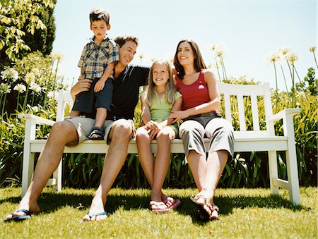 preteen thong - Family of Four Sit on a Park Bench in Summer Sunlight Together Stock Photo - Premium Royalty-Free, Code: 6106-07005601