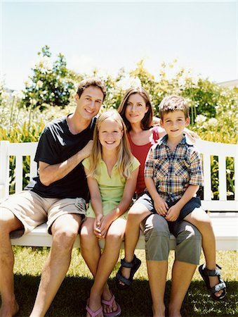 preteen thong - Family of Four Sit Together on a Park Bench in Sunlight Stock Photo - Premium Royalty-Free, Code: 6106-07005602