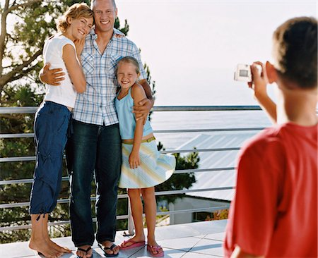 preteen thong - Young Boy Takes a Picture of His Parents and Sister Standing on Their Balcony Stock Photo - Premium Royalty-Free, Code: 6106-07005617