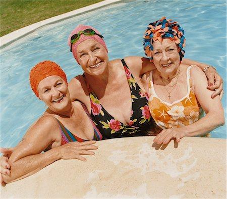 seniors and swim cap - Portrait of Three Senior Female Friends in a Swimming Pool Stock Photo - Premium Royalty-Free, Code: 6106-07006207