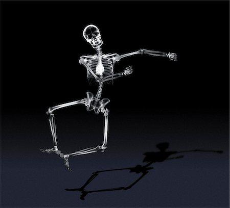Jumping skeleton Stock Photo - Premium Royalty-Free, Code: 6106-07011861