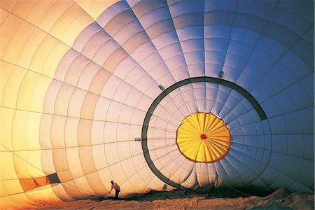 Man Working on a Hot Air Balloon Stock Photo - Premium Royalty-Free, Code: 6106-07016710