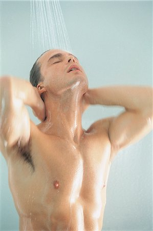Man Standing Under Shower Stock Photo - Premium Royalty-Free, Code: 6106-07016800