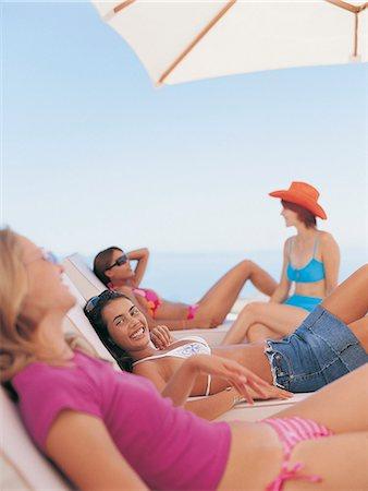 Four Female Teenagers Sunbathing Stock Photo - Premium Royalty-Free, Code: 6106-07017907