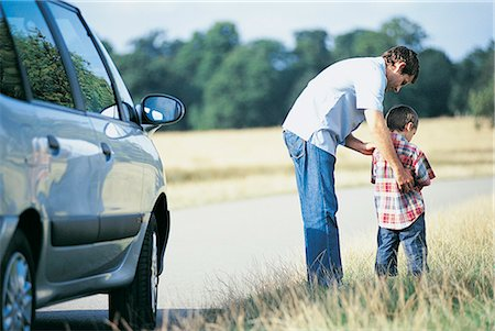 Man Helping His Son To Urinate at the Side of the Road Stock Photo - Premium Royalty-Free, Code: 6106-07020445