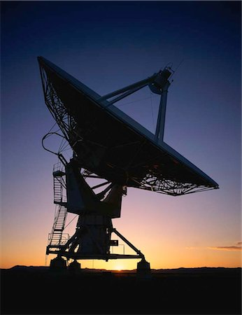 radio telescope - Array/satellite dish silhouetted by sunset Stock Photo - Premium Royalty-Free, Code: 6106-07020916