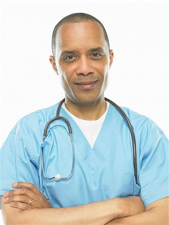 descriptive - Mature surgeon in scrubs with stethoscope, portrait Stock Photo - Premium Royalty-Free, Code: 6106-07023446