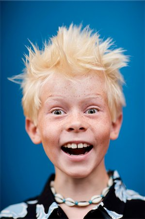 Boy (8-9) laughing, close-up, portrait Stock Photo - Premium Royalty-Free, Code: 6106-07023478