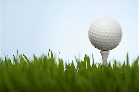 descriptive - Golf ball on tee above grass, close-up (surface level) Stock Photo - Premium Royalty-Free, Code: 6106-07023887