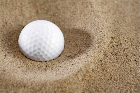 descriptive - Golf ball in sand, close-up Stock Photo - Premium Royalty-Free, Code: 6106-07023889