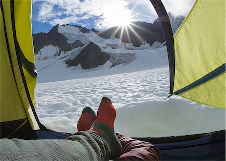 Hiker's feet in tent on glacier (personal perspective) Stock Photo - Premium Royalty-Free, Code: 6106-07024093