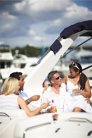 descriptive - Four people on yacht, drinking and talking Stock Photo - Premium Royalty-Free, Code: 6106-07024222