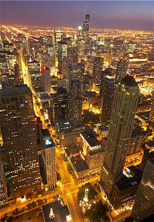 descriptive - USA, Illinois, aerial view of illuminated Chicago at dusk Stock Photo - Premium Royalty-Free, Code: 6106-07024421