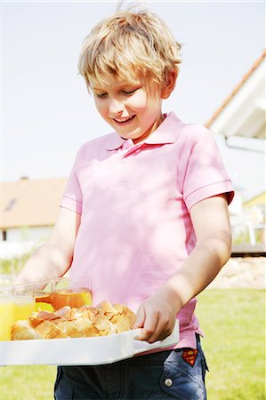 descriptive - Boy (8-9 years) walking carrying food tray Stock Photo - Premium Royalty-Free, Code: 6106-07024933