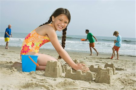 southern california - Girl (8-9) making sand castle on beach, portrait Stock Photo - Premium Royalty-Free, Code: 6106-07025748