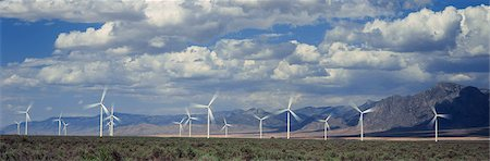Field of wind generators with mountains and sky Photographie de stock - Premium Libres de Droits, Code: 6106-07029275