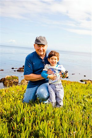 A grandfather and his grandson together. Stock Photo - Premium Royalty-Free, Code: 6106-07029357