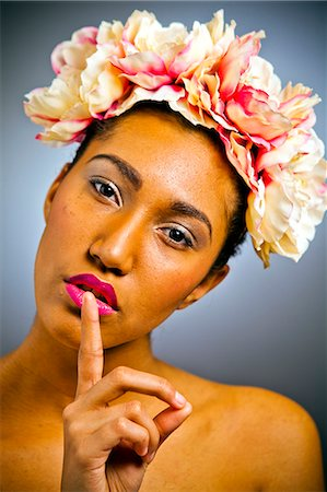 A young women wearing a floral head dress. Stock Photo - Premium Royalty-Free, Code: 6106-07029677