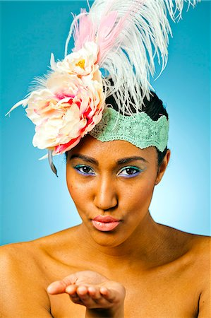 A young women wearing a floral head dress. Stock Photo - Premium Royalty-Free, Code: 6106-07029675