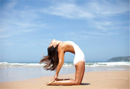 flexible (people or objects with physical bendability) - Woman doing yoga back bend on Australian beach Stock Photo - Premium Royalty-Free, Code: 6106-07029627