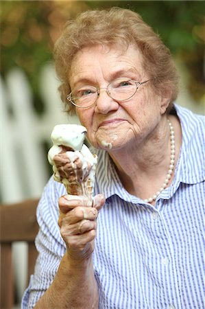 families eating ice cream - Old lady with ice cream smiling Stock Photo - Premium Royalty-Free, Code: 6106-07030072