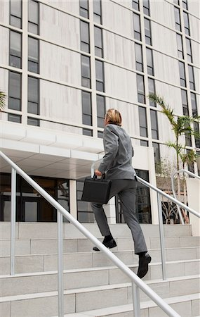 businessman climbing stairs Stock Photo - Premium Royalty-Free, Code: 6106-07119958