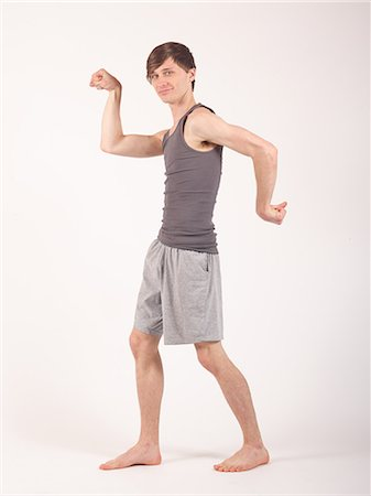 Young man excersing Stock Photo - Premium Royalty-Free, Code: 6106-07119996
