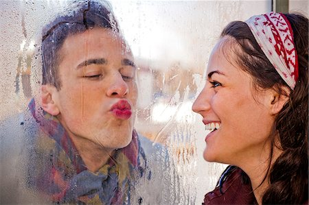 pucker - A couple having fun during winter. Stock Photo - Premium Royalty-Free, Code: 6106-07120049