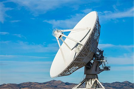 radio telescope - Satellite dish in desert with blue sky Stock Photo - Premium Royalty-Free, Code: 6106-07120323