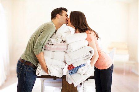 Couple doing laundry Stock Photo - Premium Royalty-Free, Code: 6106-07120410