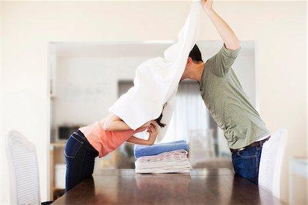 Couple doing laundry Stock Photo - Premium Royalty-Free, Code: 6106-07120411