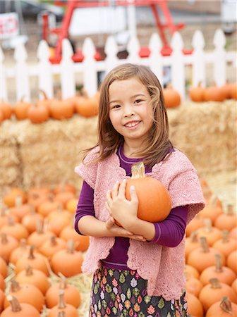 selecting - Kids at pumpkin patch Stock Photo - Premium Royalty-Free, Code: 6106-07120580