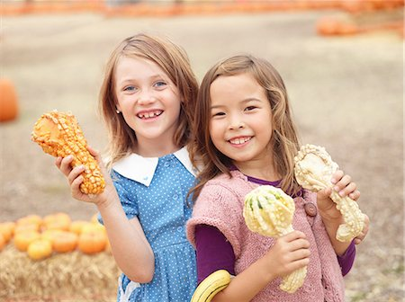 selecting - Kids at pumpkin patch Stock Photo - Premium Royalty-Free, Code: 6106-07120595