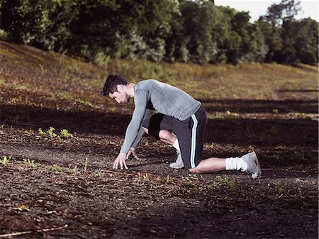 sprint - athlete in sprinting position Stock Photo - Premium Royalty-Free, Code: 6106-07121431
