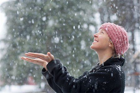 Woman excited to see snowfall in winter Stock Photo - Premium Royalty-Free, Code: 6106-07121642