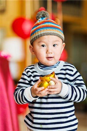 Celebrating Chinese new year Stock Photo - Premium Royalty-Free, Code: 6106-07121734