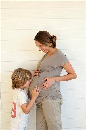 pregnant women kissing - pregnant woman with boy Stock Photo - Premium Royalty-Free, Code: 6106-07349406