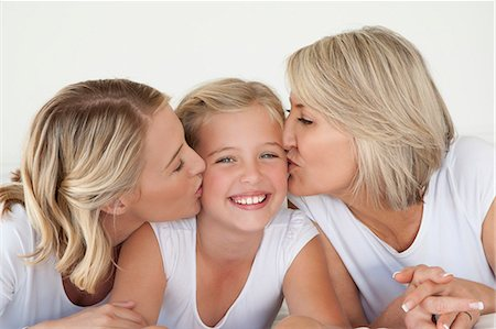 daughter kissing mother - Mother And Grandmother Kissing Girl Stock Photo - Premium Royalty-Free, Code: 6106-07349509
