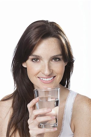 drinking water glass - Close up of smiling woman holding glass of water Stock Photo - Premium Royalty-Free, Code: 6106-07349936