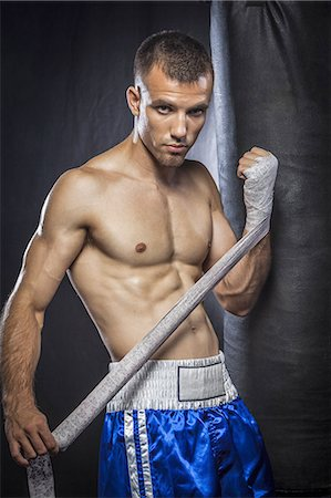 shirtless men - Male boxer wrapping hand with bandage Stock Photo - Premium Royalty-Free, Code: 6106-07350383