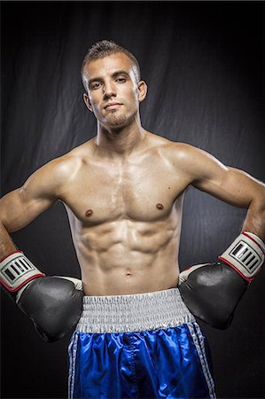 shirtless men - Male boxer standing with arms on waist Stock Photo - Premium Royalty-Free, Code: 6106-07350388