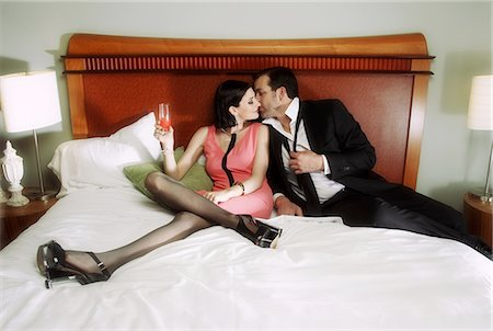couple sitting in bed ready to kiss Stock Photo - Premium Royalty-Free, Code: 6106-07350471