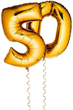Gold balloons in the shape of a number 50 Stock Photo - Premium Royalty-Free, Code: 6106-07350528
