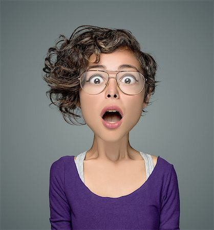 Close up portrait of a surprised teenage girl Stock Photo - Premium Royalty-Free, Code: 6106-07350992